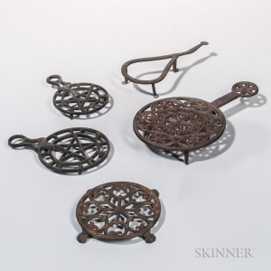 Four Cast Iron and One Wrought Iron Trivets