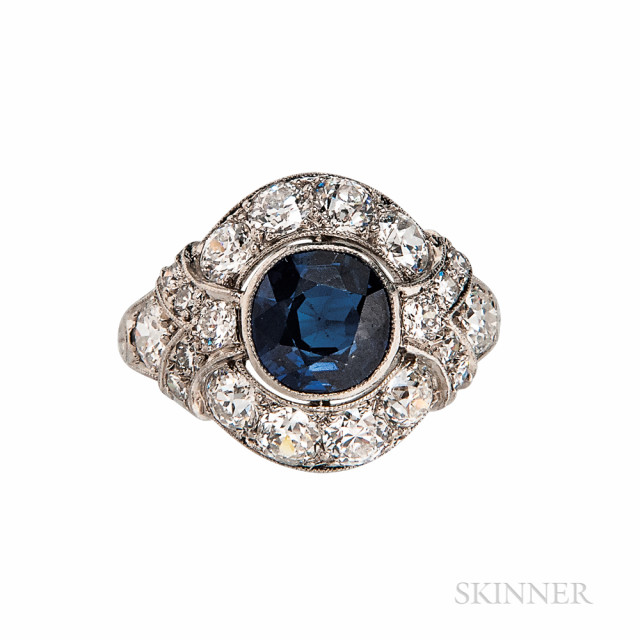 Art Deco Platinum, Sapphire, and Diamond Ring, bezel-set with a circular-cut sapphire measuring approx. 6.76 x 6.56 x 4.00 mm, and old European- and single-cut diamonds, size 6.