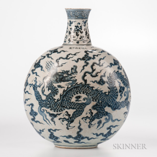 Large Blue and White Moon Flask Vase, China, Ming dynasty style, decorated with a continuous dragon and cloud design with two three-clawed dragons below a meander band and a floral scroll frieze